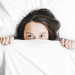 Woman hiding her acne
